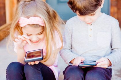 girl and boy using Android smartphones